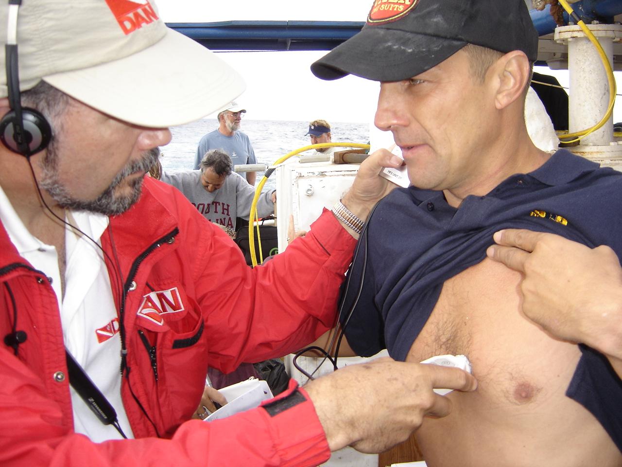 2006 Dr DeNoble conducting post dive doppler tests on Eduardo Pavio