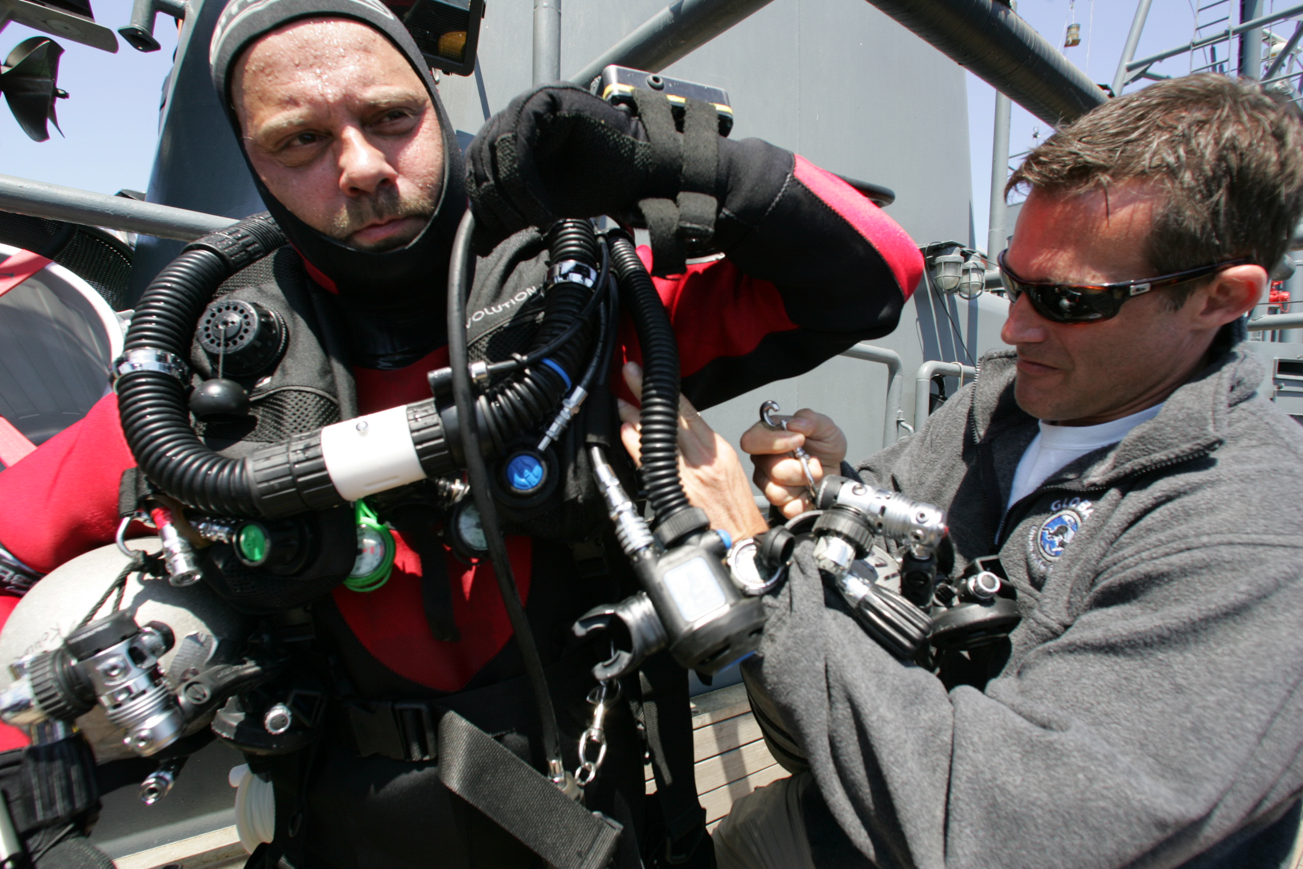 2009 004 All bottom divers are assited in kitting up to reduce thermal stress, and for another set of eyes to go over all connections and fittings. Here Jarrod Jablonski helps me kitt up.