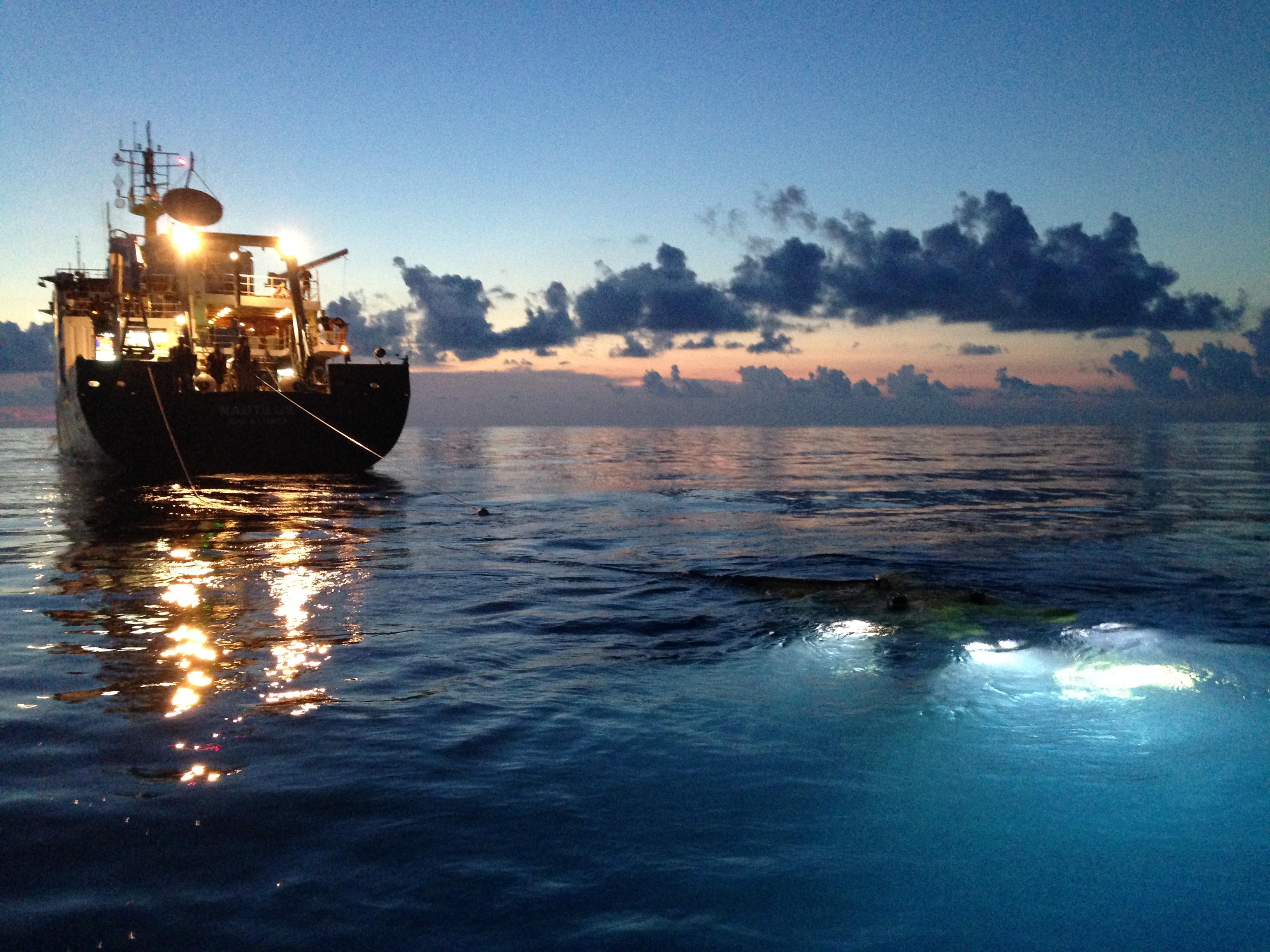 Nautilus recovering Hercules at dusk.